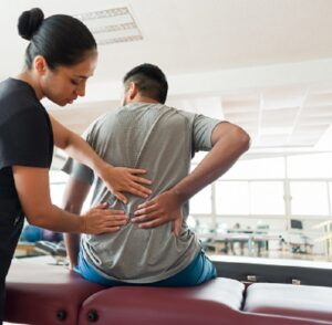 Patient pointing out low back pain