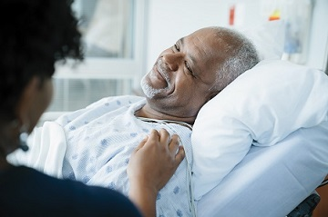Man in a hospital bed After Cervical Spine Surgery